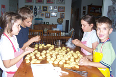 Kids making Resurrection Rolls to celebrate Resurrection Sunday