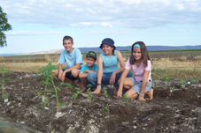 Photo of the kids after planting our veggie plot