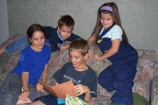 Joshua opening a present made by his siblings